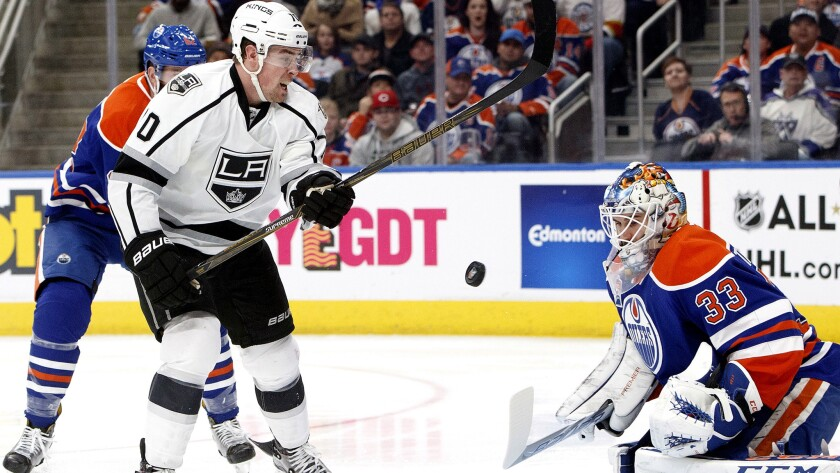 Kings forward Tanner Pearson (70) is stopped by Oilers goalie Cam Talbot (33) during the first period of their game Thursday.