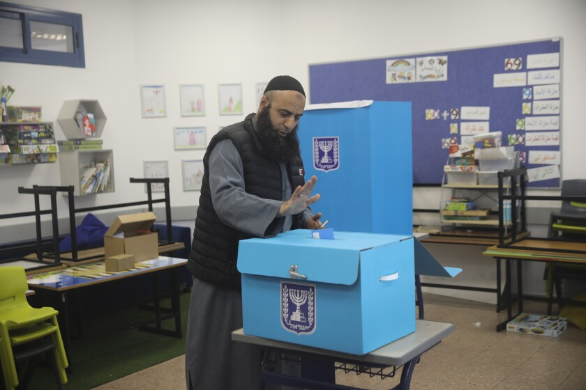 A man votes during elections in Tamra, an Arab town in Israel, Monday, March 2, 2020. (AP Photo/Mahmoud Illean)