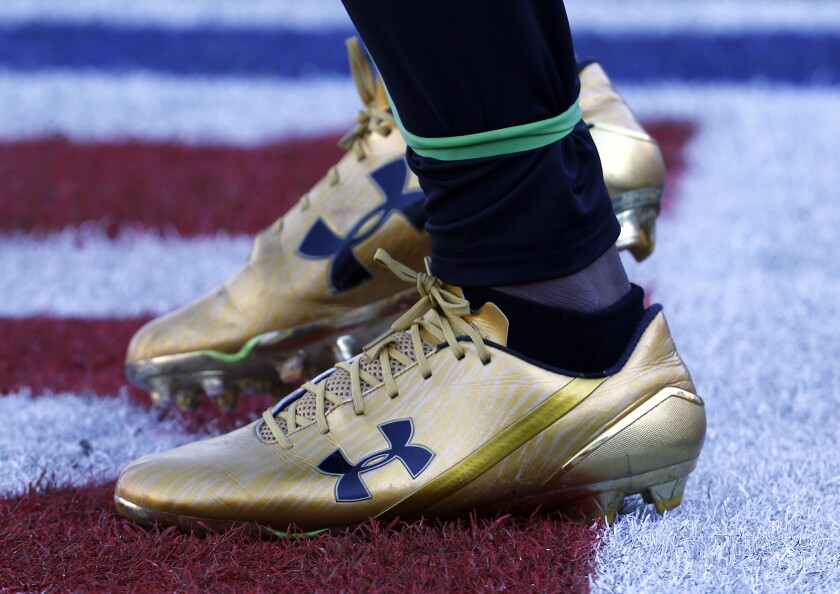 Jacksonville Jaguars' T.J. Yeldon wears Under Armour cleats for an NFL football game against the Seattle Seahawks in 2017. A strong quarter from Under Armour is overshadowed by a federal investigation into its accounting practices.