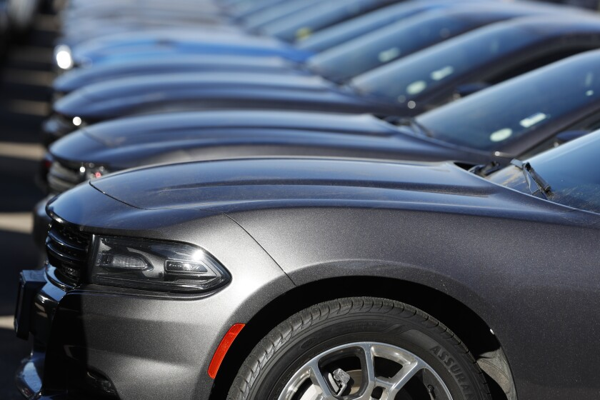 FILE - In this Feb. 2, 2020 file photo a long row of unsold Charger sedans sits at a Dodge dealership in Littleton, Colo. Certified pre-owned vehicles present a great opportunity for used-car shoppers now. (AP Photo/David Zalubowski, File)