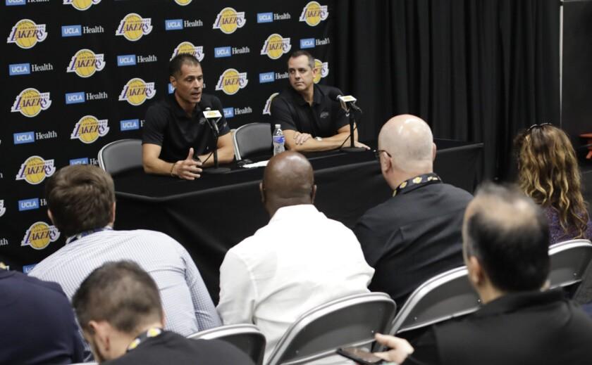 Rob Pelinka speaks alongside coach Frank Vogel during the Lakers' media day on Friday.