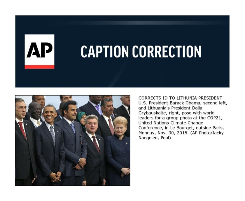 CORRECTS ID TO LITHUNIA PRESIDENT U.S. President Barack Obama, second left, and Lithuania's President Dalia Grybauskaite, right, pose with world leaders for a group photo at the COP21, United Nations Climate Change Conference, in Le Bourget, outside Paris, Monday, Nov. 30, 2015. (AP Photo/Jacky Naegelen, Pool)