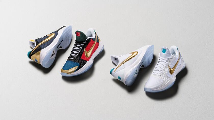 Two pairs of Kobe V Protro sneakers.