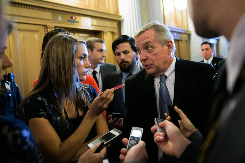 "Sen. Richard J. Durbin (D-Ill.) discusses gun control with reporters on Capitol Hill a day after the Washington Navy Yard rampage. He said on the Senate floor, ""God forbid we go on with business as usual today and not understand what happened yesterday."""