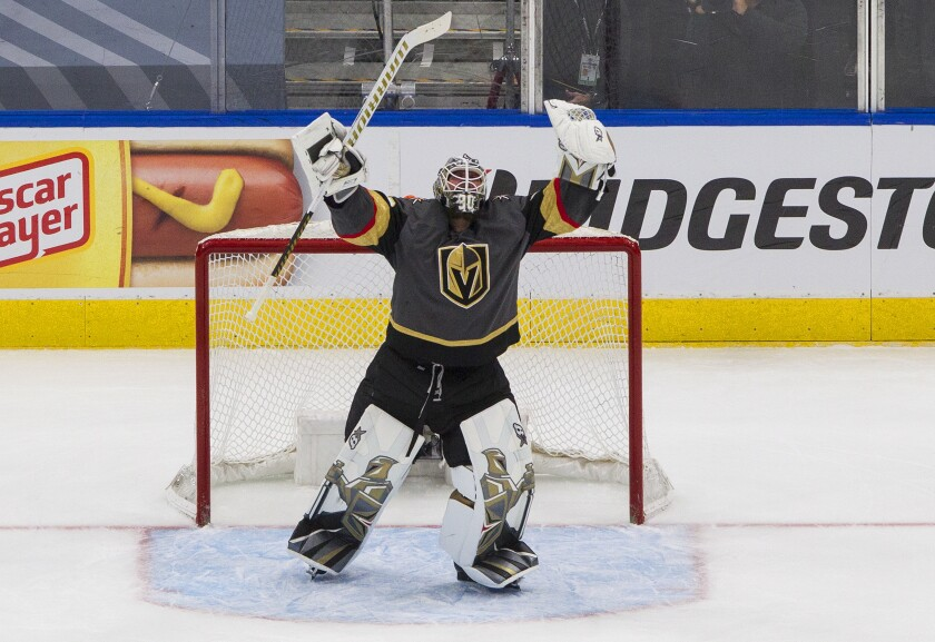 Vegas Golden Knights goalie Robin Lehner celebrates the team's win over the Vancouver Canucks in Game 7 of an NHL hockey second-round playoff series, Friday, Sept. 4, 2020, in Edmonton, Alberta. (Jason Franson/The Canadian Press via AP)