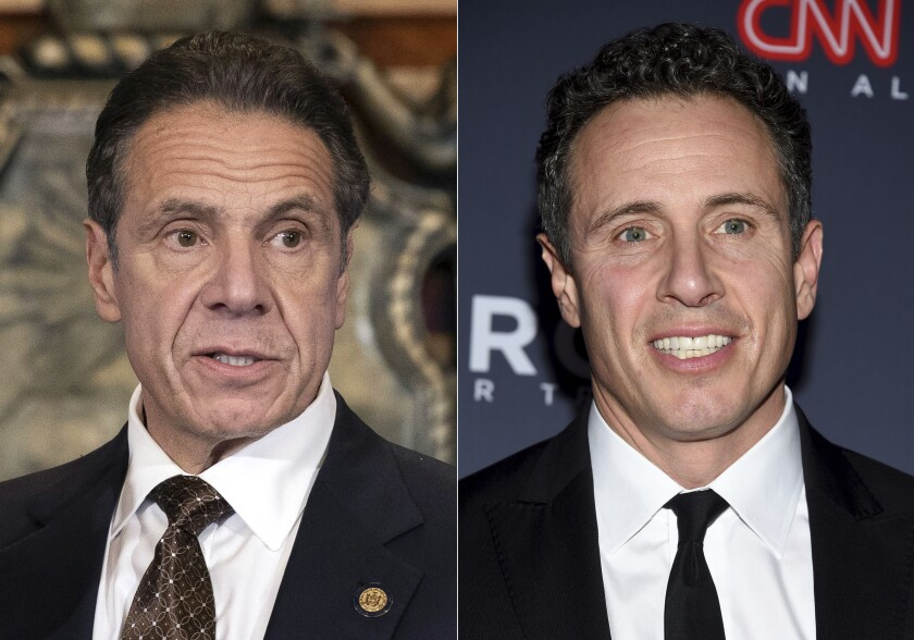 """FILE - New York Gov. Andrew M. Cuomo appears during a news conference about the COVID-19at the State Capitol in Albany, N.Y., on Dec. 3, 2020, left, and CNN anchor Chris Cuomo attends the 12th annual CNN Heroes: An All-Star Tribute at the American Museum of Natural History in New York on Dec. 9, 2018. Chris Cuomo has told viewers that he """"tried to do the right thing"""" when balancing his role as a journalist and brother to outgoing New York Gov. Andrew Cuomo, who announced his resignation following allegations of sexual harassment. Chris Cuomo returned to the air Monday, Aug. 16, 2021, for the first time following his brother's announcement and addressed what has become an awkward issue for his employer. (Mike Groll/Office of Governor of Andrew M. Cuomo via AP, left, and Evan Agostini/Invision/AP)"""