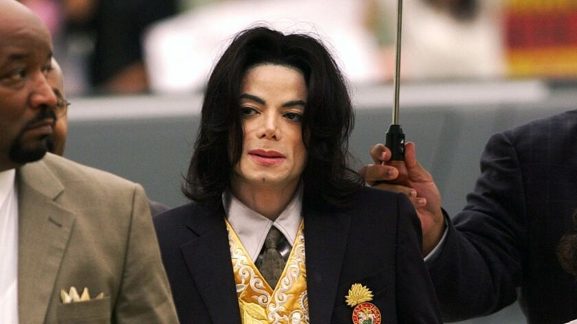 FILE - In this May 25, 2005 file photo, Michael Jackson arrives at the Santa Barbara County Courthou