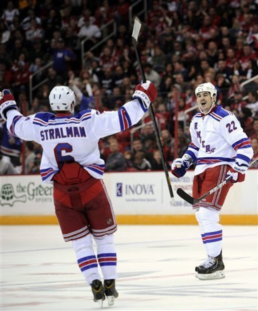 New York Rangers center Brian Boyle (22) celebrates his goal with Anton Stralman (6) during the second period of an NHL hockey game against the Washington Capitals, Sunday, March 10, 2013, in Washington. (AP Photo/Nick Wass)