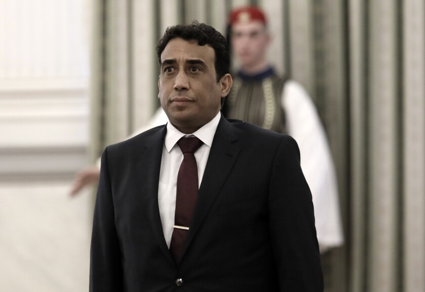 FILE - In this Tuesday, Dec. 18, 2018 file photo Mohamed Younis A.B. Menfi Ambassador of Libya in Greece attends a ceremony at the Presidential Palace in Athens. Greece's foreign minister says on Friday, Dec. 6, 2019, his country is expelling the Libyan ambassador in the latest escalation of a dispute over a controversial deal between Libya's UN-supported government and Turkey on maritime boundaries in the Mediterranean. (John Liakos/InTime News via AP, File)