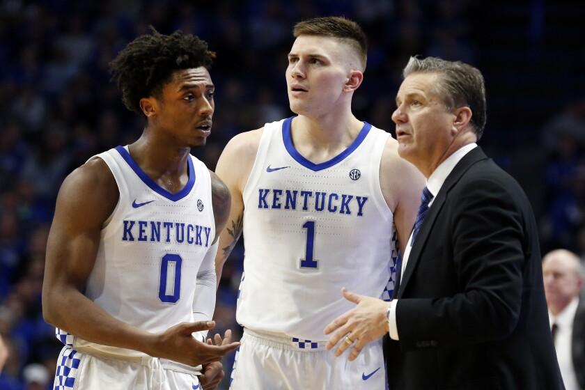 Kentucky's Ashton Hagans and Nate Sestina talk with coach John Calipari.