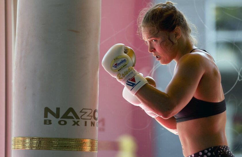 Ronda Rousey works out at Glendale Fighting Club in Glendale in July. The UFC fighter insists she makes more per second than boxer Floyd Mayweather.