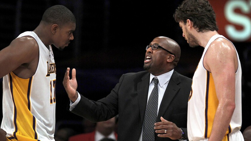 Coach Mike Brown, center, had a relatively short tenure with the Lakers despite having two 7-footers in Andrew Bynum, left, and Pau Gasol.