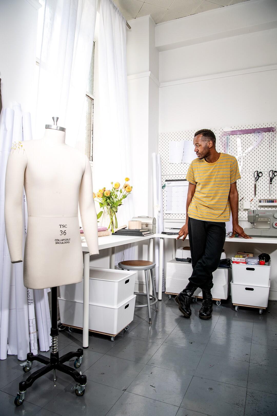 Portrait of fashion designer Kenneth Nicholson wearing his own label inside his studio in DTLA.