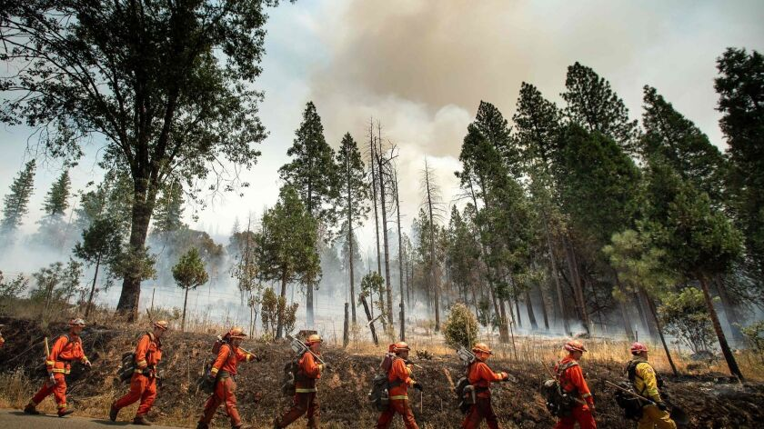 Inmate crews work to defend Jerseydale from the incoming Ferguson fire, which ignited July 13 outside Yosemite National Park.