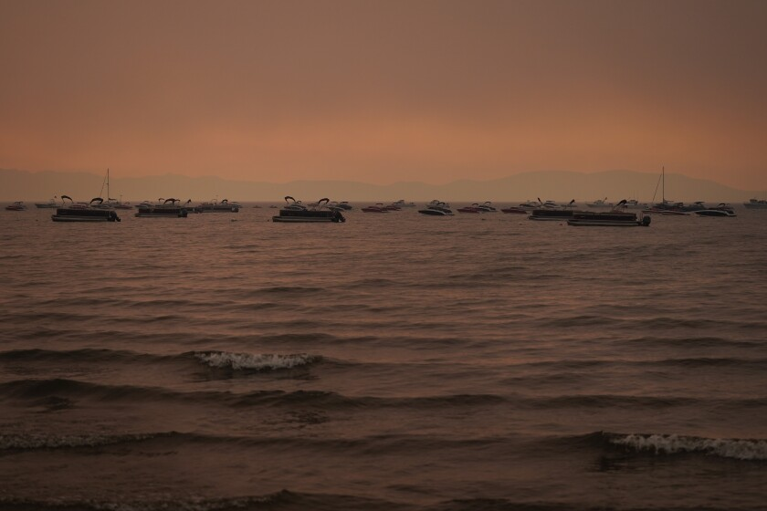 Boats float on Lake Tahoe on Aug. 31.