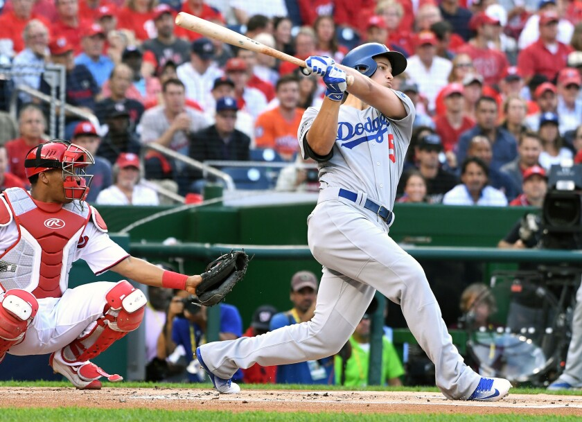 Dodgers shortstop Corey Seager follows through after hitting a home run against Washington in Game 1 of the NLDS on Friday at Nationals Park.