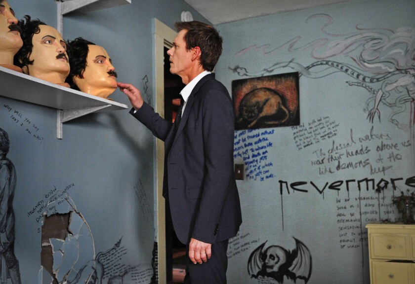 """Kevin Bacon with Edgar Allan Poe masks in """"The Following."""""""