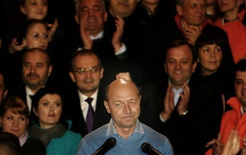 Incumbent President Traian Basescu, seen, after seeing exit polls in the presidential elections runoff in Bucharest, Romania, Sunday, Dec. 6, 2009. Both candidates claimed victory but three exit polls indicate his opponent, Social Democracy party candidate Mircea Geoana as the winner of the election. (AP Photo/Vadim Ghirda)