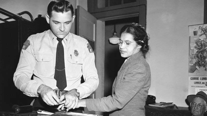 The arrest of Rosa Parks, whose refusal to move to the back of a bus touched off the Montgomery, Ala., bus boycott.
