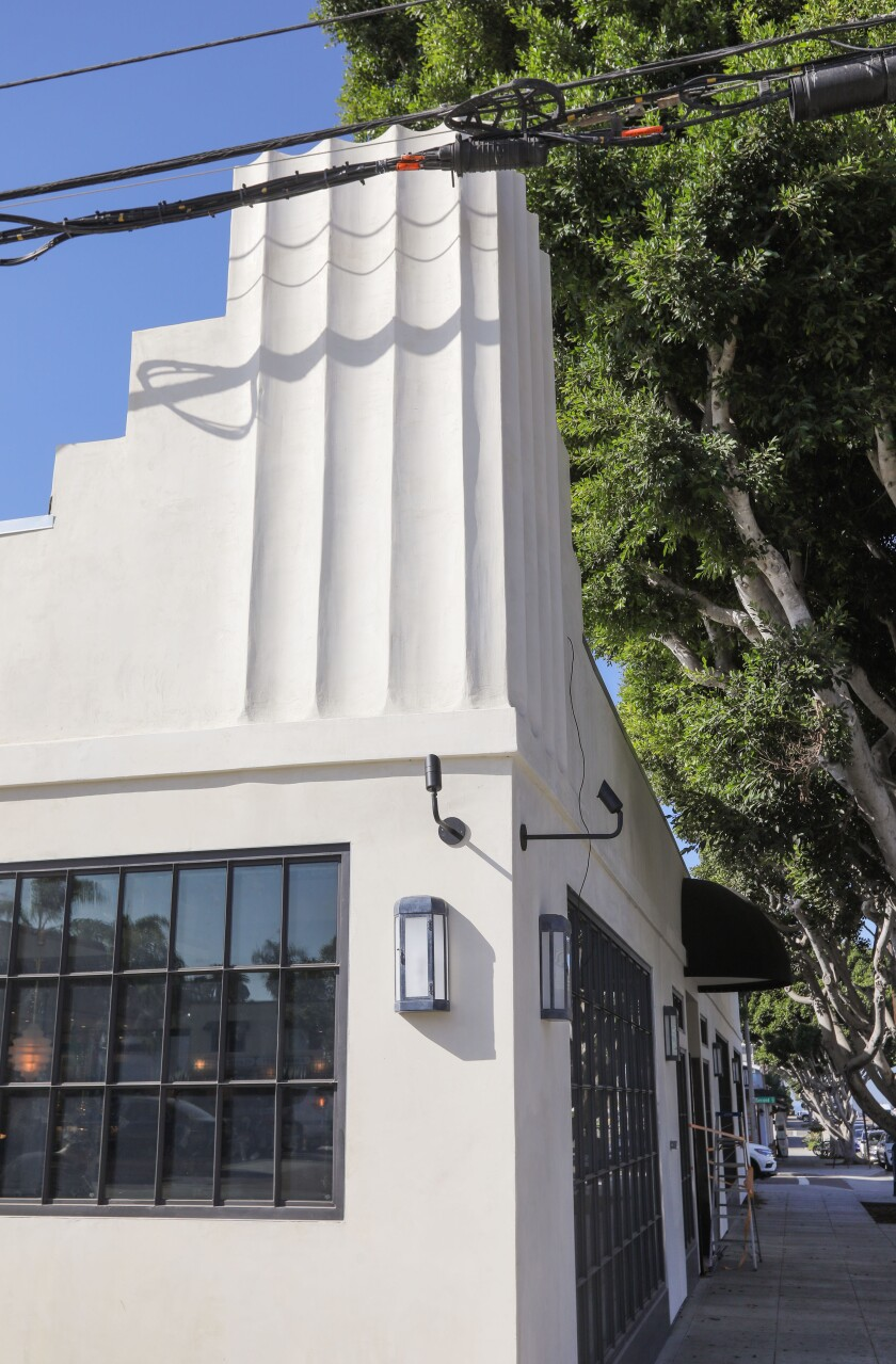 The prominent corner vertical feature of the renovated 1920s art-deco building in downtown Encinitas housing new Herb & Sea Restaurant has been preserved.