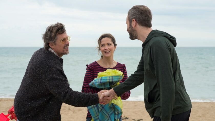 This image released by Lionsgate and Roadside Attractions shows Ethan Hawke, from left, Rose Byrne a