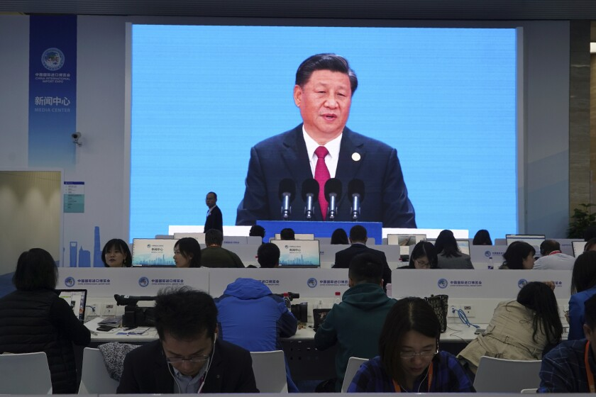 Chinese President Xi Jinping is seen on a live broadcast speaking at the media center during the opening of the China International Import Expo in Shanghai, Tuesday, Nov. 5, 2019. Xi promised Tuesday to open China wider to imports and foreign investment at the start of a high-profile trade fair meant to rebrand the country as a global customer and warned against trade protectionism. (AP Photo/Dake Kang)