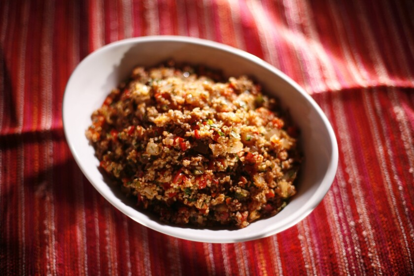 Spicy Bulgar salad with sweet peppers and pepper paste.