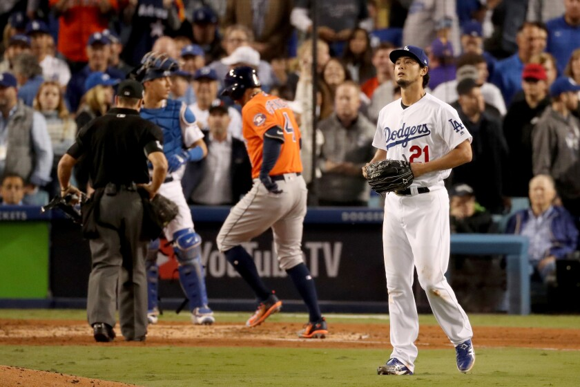Dodger pitcher Yu Darvish looks on after giving up a two-run homer to the Astros' George Springer during Game 7 of the 2017 World Series.