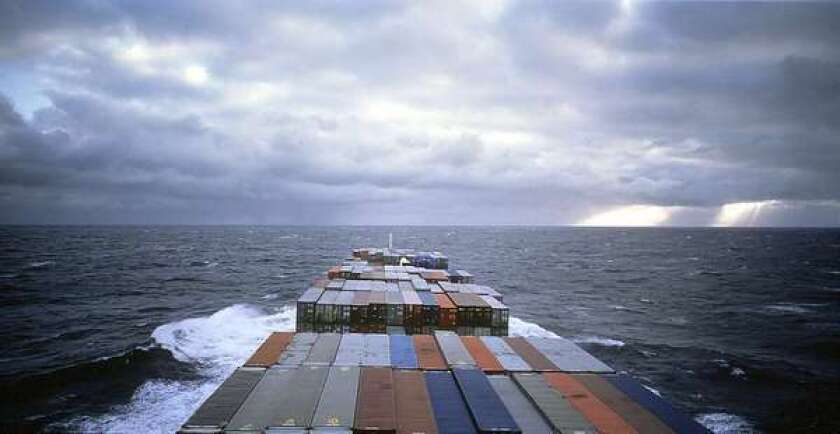 A photograph by Allan Sekula showing shipping containers in the mid-Atlantic.