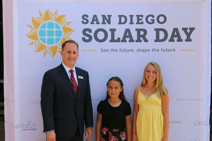 Mike Teresso, president of Baker Electric Solar, (left) with Itzel Sanchez and Hailey Treleaven at San Diego Solar Day at the Reuben H. Fleet Science Center.