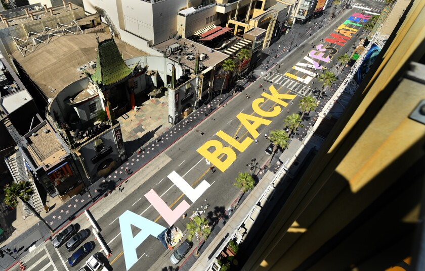"""All Black Lives Matter"" is painted on Hollywood Boulevard in front of the Dolby Theatre."