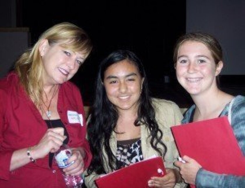 Author Kristin Elizabeth Clark with Mary Ford and Kate Sequeira, both students from San Dieguito Academy. Photos/Diane Welch