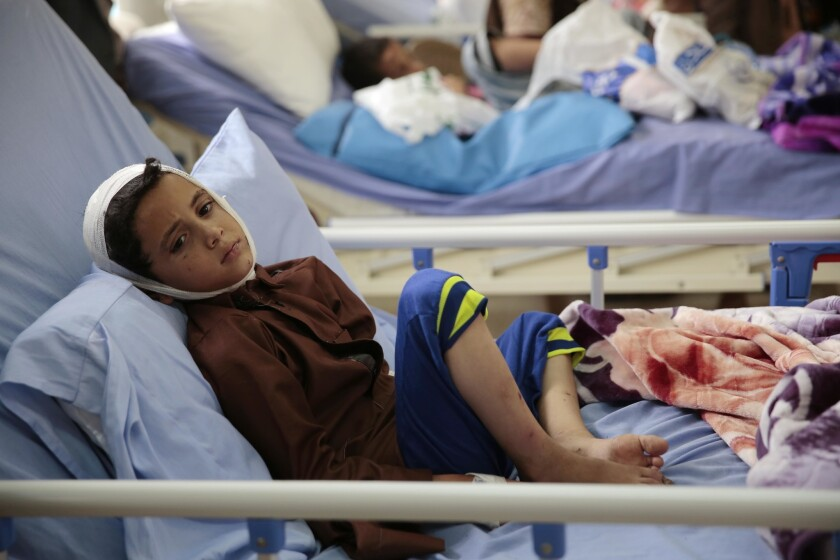 A child injured in the deadly Saudi-led coalition airstrike rests in a hospital in Saada, Yemen, in August.