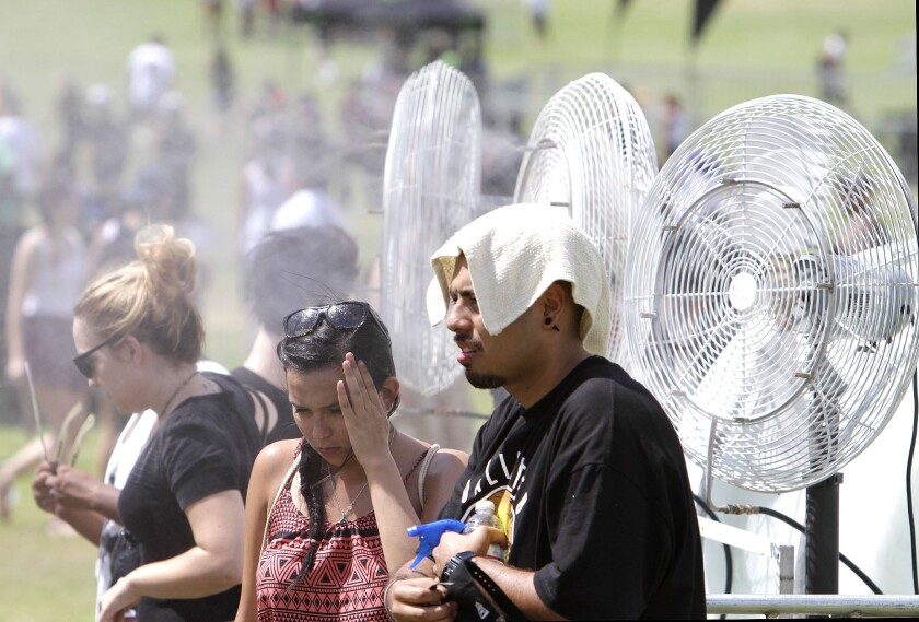 Fans try to cool off amid the brutal heat of Day 1 of 2013's edition of Rock the Bells at San Manuel Amphitheater in San Bernardino.