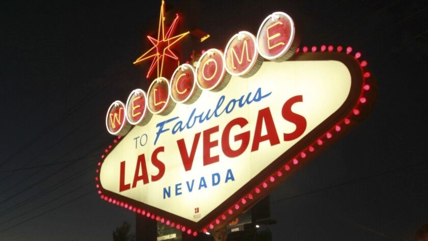 "File - In this Oct. 4, 2012, file photo, the ""Welcome to Fabulous Las Vegas"" neon sign is outlined i"
