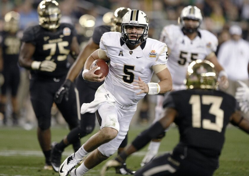 Central Florida quarterback Blake Bortles (5) dashes for a rushing touchdown as Baylor safety Terrell Burt (13) defends during the second half of the Fiesta Bowl NCAA college football game, Wednesday, Jan. 1, 2014, in Glendale, Ariz. (AP Photo/Rick Scuteri)