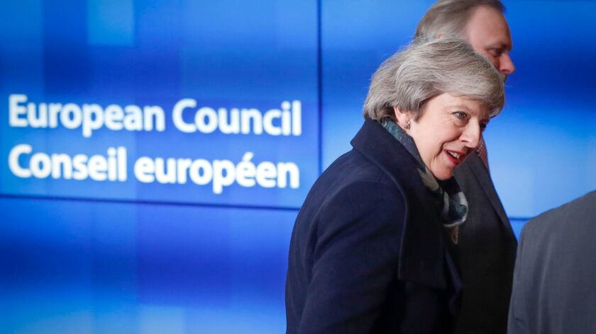 British Prime Minister Theresa May arrives for a meeting at the European Council in Brussels.