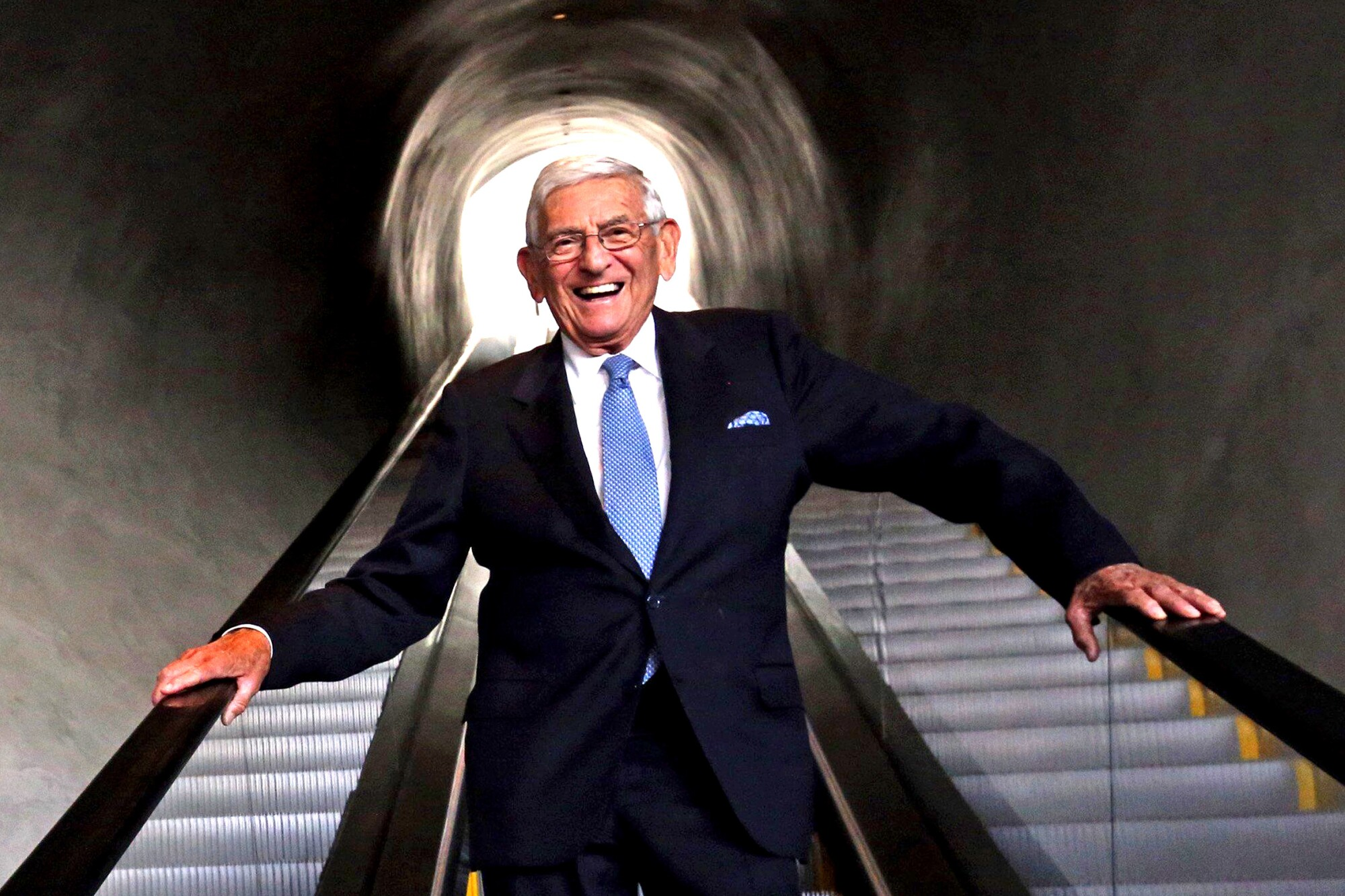 Eli Broad stands inside the Broad museum.
