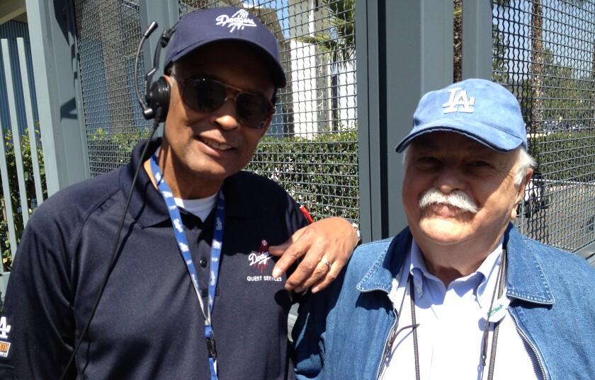 Dodger Stadium worker Errol Coffey and Dodgers fan Philip Brooks in 2012