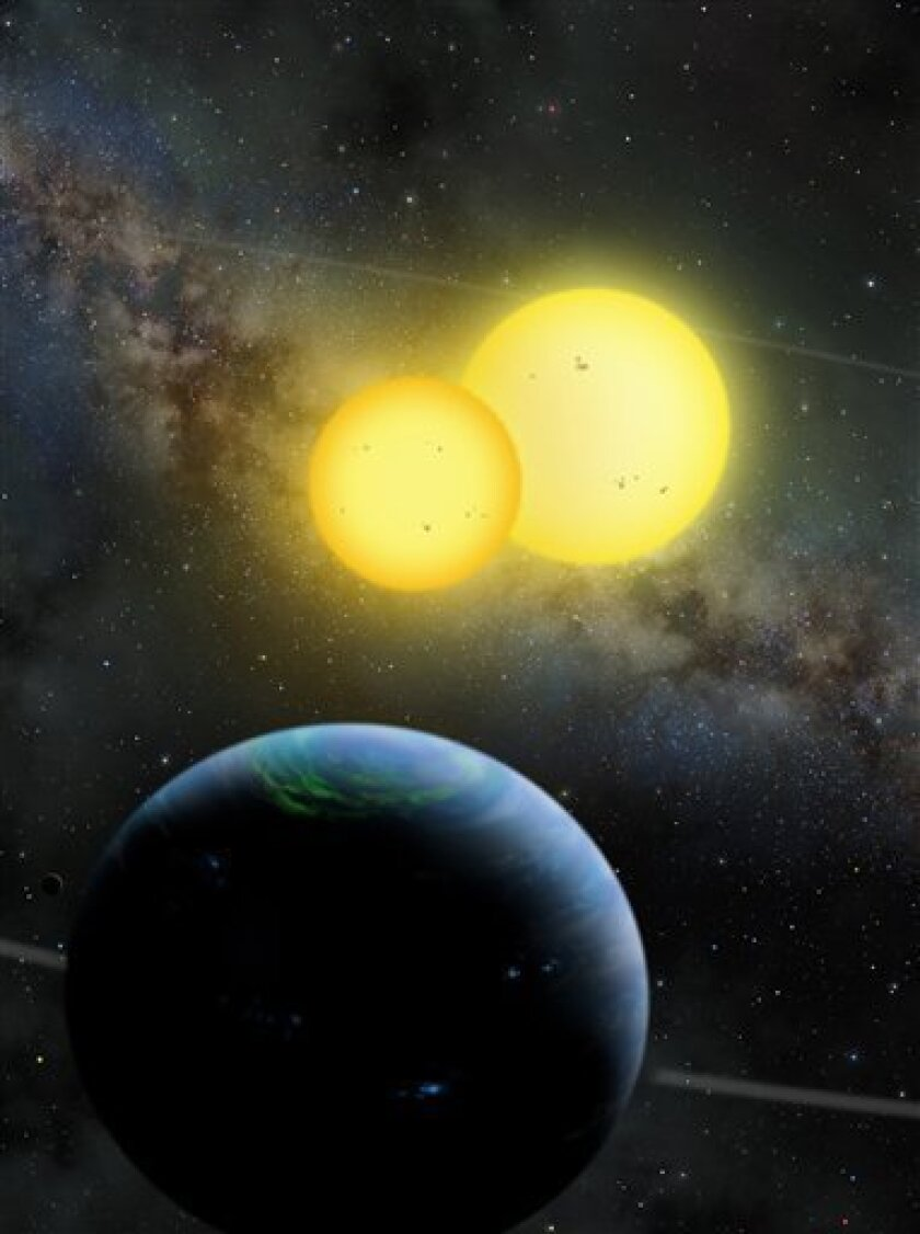 This handout illustration provided by San Diego State University, shows a newly discovered planet, called Kepler 35, that circles not one but two stars. Scientists thought this type of two-sun system _ made famous as the home planet of the fictional Luke Skywalker _ is too unstable to support planets. But so far they've found three of these planets with two suns, showing that planets seem to be everywhere. The study is in this week's journal Nature. (AP Photo/Lynette R. Cook, San Diego State University)