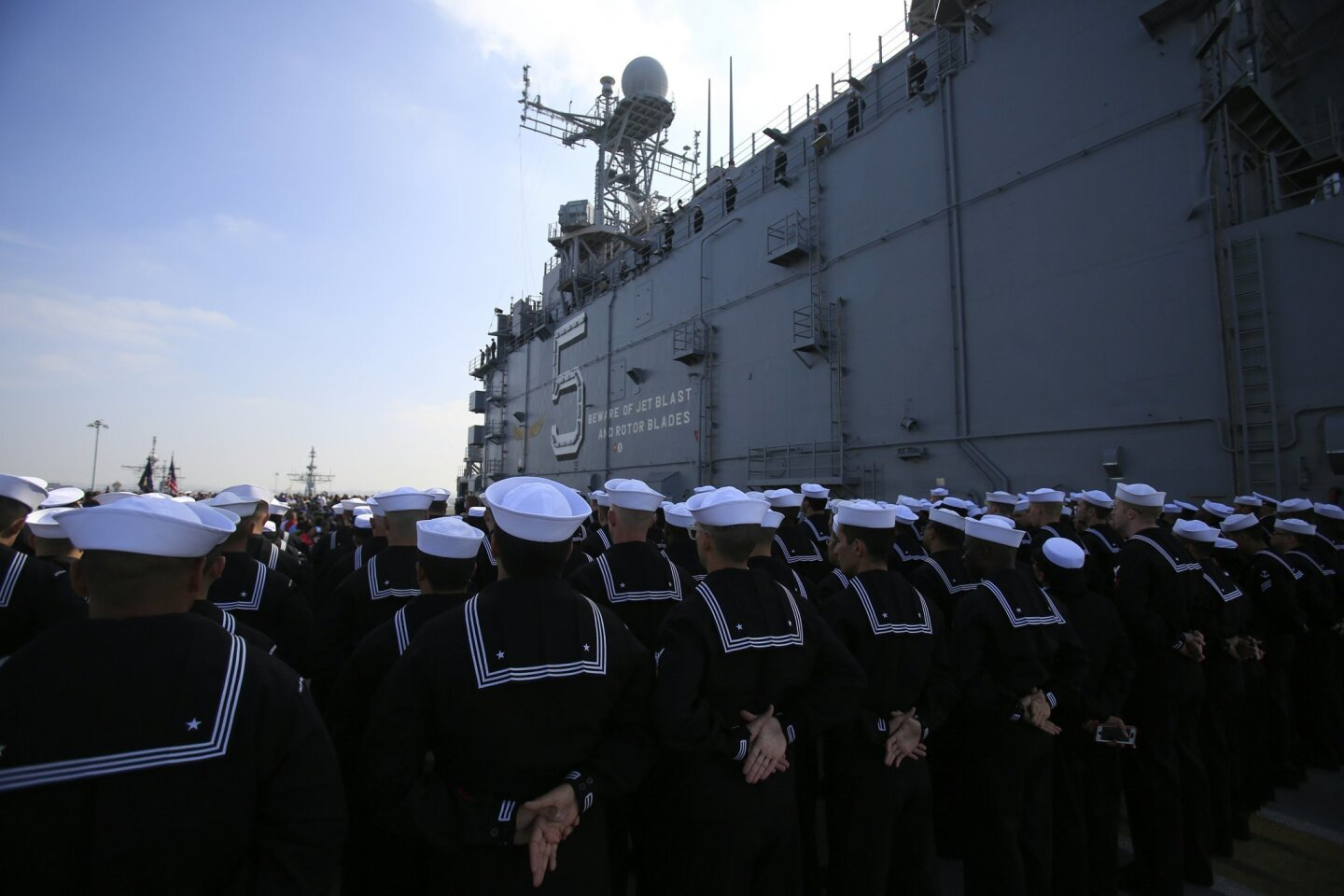 The crew of the USS Peleliu stand in formation during the decomissioning ceremony for the ship Tuesday morning at Naval Base San Diego.