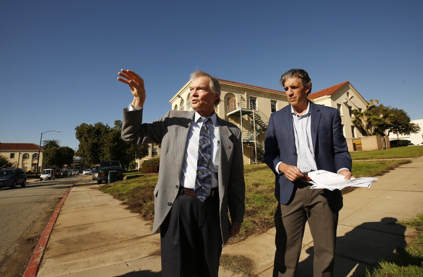 Steve Peck, left, president and CEO of U.S. Vets, and Brian D'Andrea, senior vice president of housing for Century Housing, talk about plans for new veteran housing at the West Los Angeles VA campus.