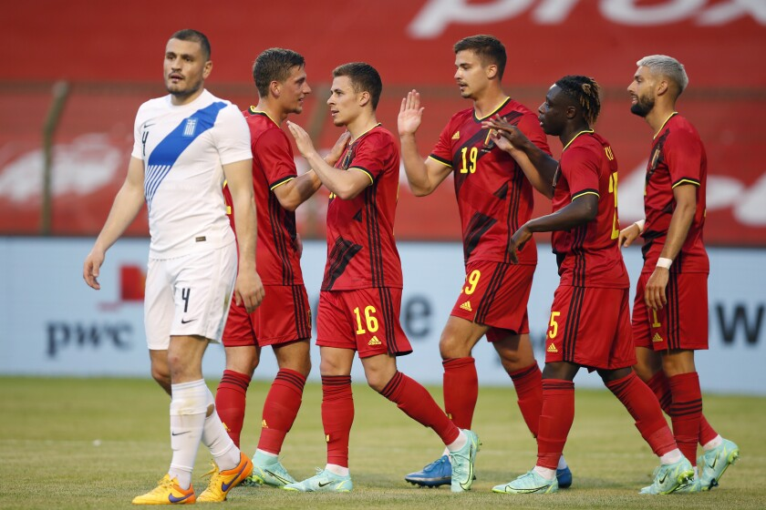 Belgium's Thorgan Hazard, third left, is congratulated after scoring the opening goal of the match during the international friendly soccer match between Belgium and Greece at the King Baudouin stadium in Brussels, Thursday, June 3, 2021. (AP Photo/Francisco Seco)