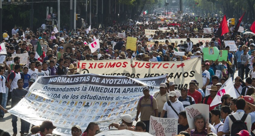 Thousands of protesters march in Mexico City on Oct. 8 to demand justice in the case of 43 students who went missing in Iguala, in Guerrero state.