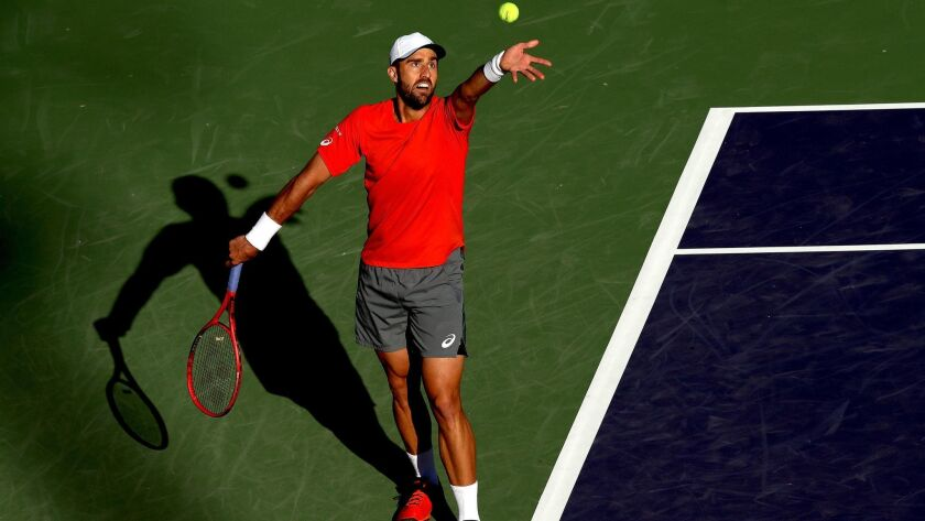 Steve Johnson serves to Taylor Fritz during the BNP Paribas Open at the Indian Wells Tennis Garden on Friday.