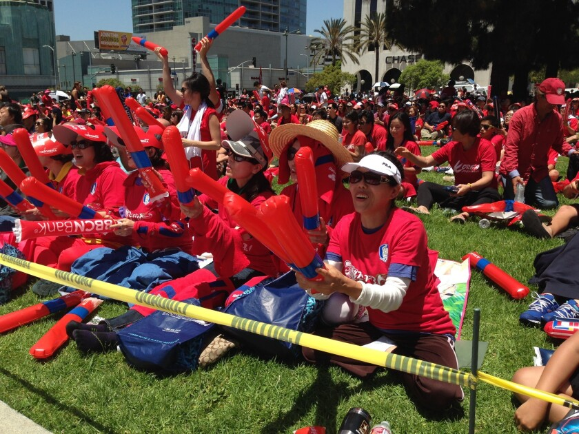 Hundreds of fans gather in Koreatown on Sunday to watch Algeria take on South Korea at the World Cup.