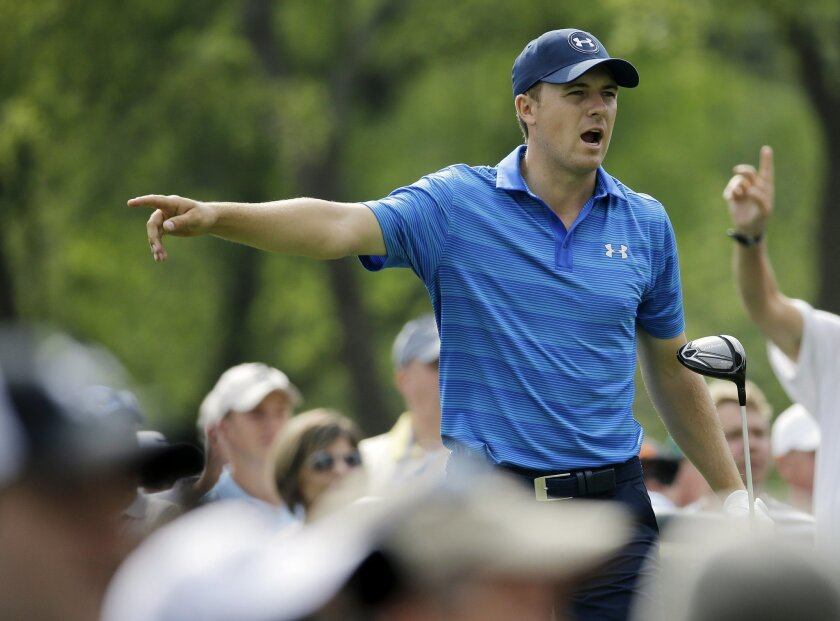 Jordan Spieth points to the direction of his tee shot on the 15th hole during the first round of the Memorial golf tournament, Thursday, June 2, 2016, in Dublin, Ohio. (AP Photo/Darron Cummings)