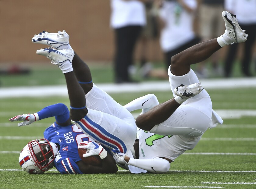 North Texas safety Makyle Sanders (10) puts SMU's running back Ulysses Bentley IV, left, on his head with a strong tackle during an NCAA college football game Saturday, Sept. 19, 2020, in Denton, Texas. (Al Key/The Denton Record-Chronicle via AP)