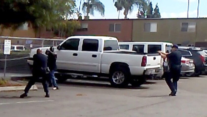 An image from cellphone video of a deadly confrontation between two El Cajon police officers and Alfred Olango. His sister says she told officers that he was mentally ill.
