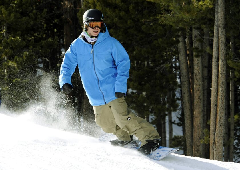 FILE - In this Dec. 13, 2011, snowboarder Kevin Pearce hits the slopes in Breckenridge, Colo., for the first time in almost two years. A near-fatal halfpipe crash while training for the 2010 Olympics ended Pearce's snowboarding career and changed his life forever. In May 2016, Pearce is still recov